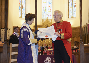 The Chancellor receiving the Letters Patent from the Lord Lyon