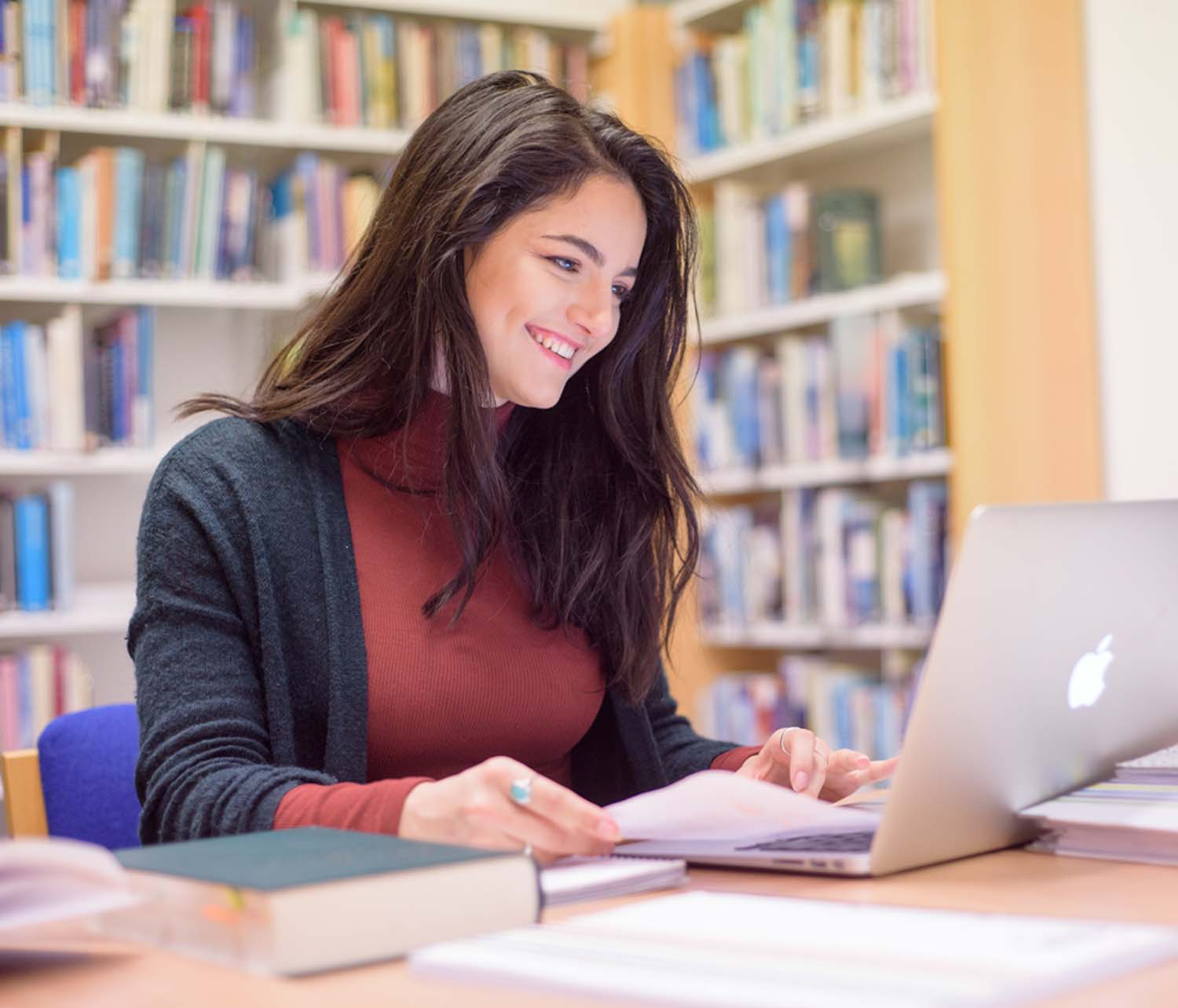 Female studying in library
