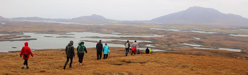 students walking across Western Isles moorland