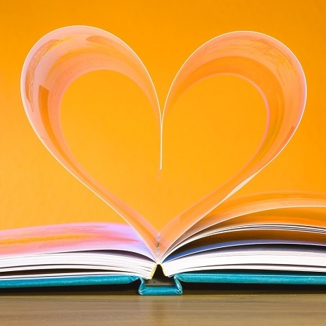 An open book with pages in the shape of a heart