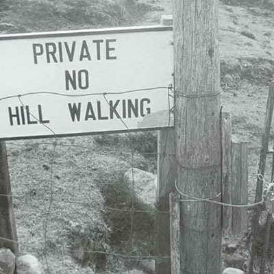 'Private no hill walking' sign on fence; credit Sam Maynard