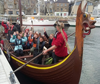 Summer course participants sailing on a replica Viking ship in Shetland