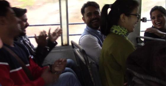 Students laughing on a bus
